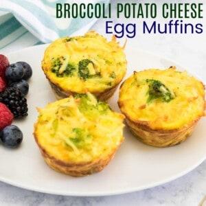 three broccoli potato cheese egg muffins ona white plate with berries