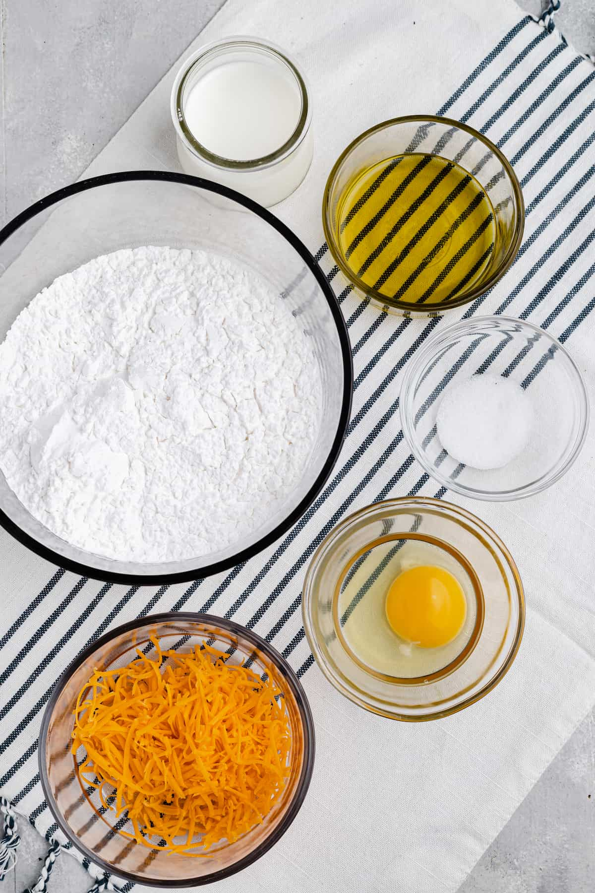 bowl of flour, egg, cheese, and oil