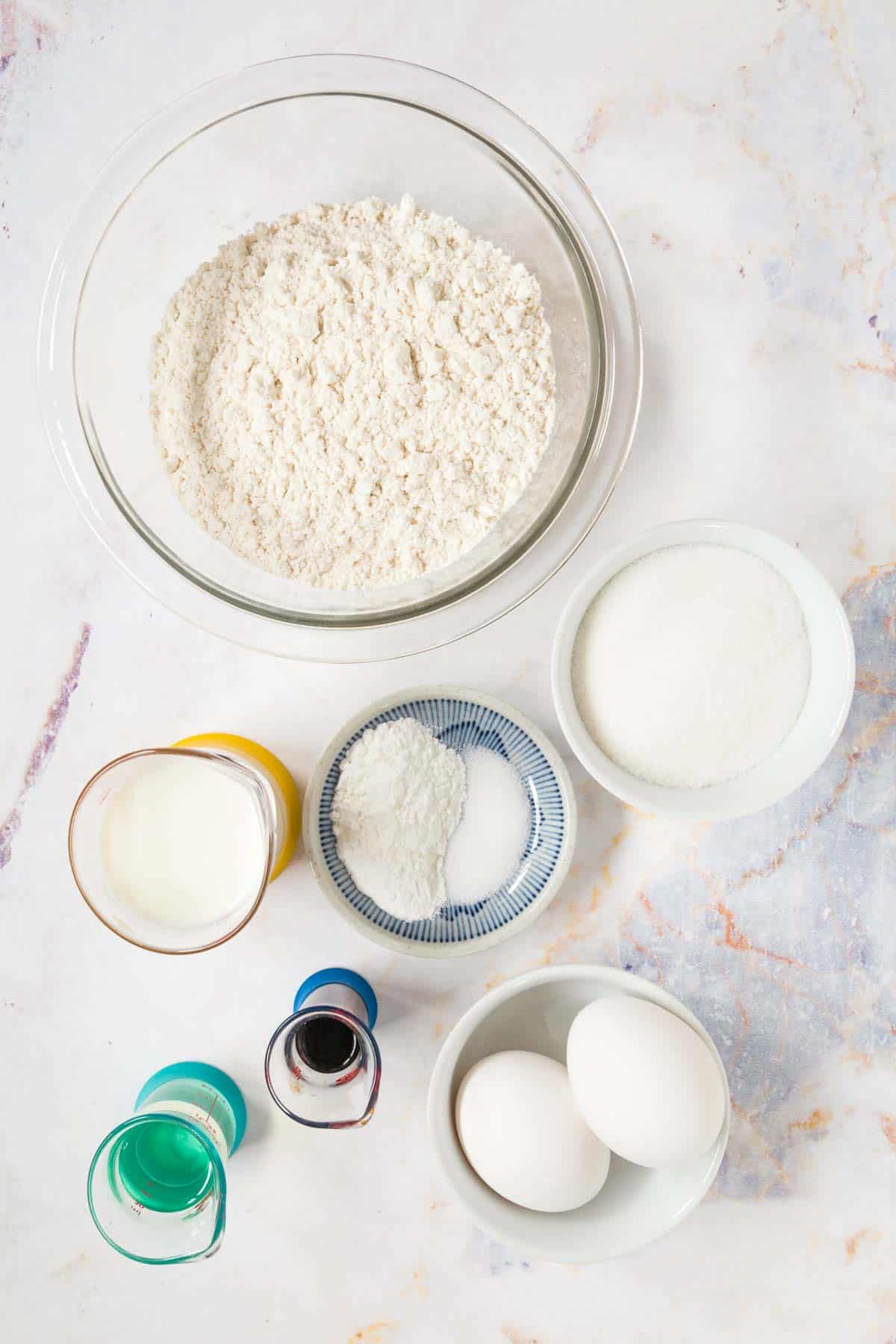 ingredients for gluten free new york crumb cake, including flour, vanilla, eggs and salt