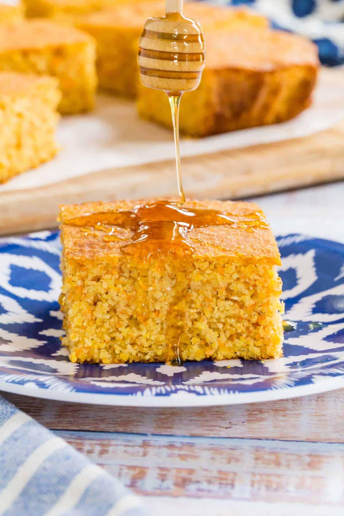 drizzling honey on a slice of cornbread