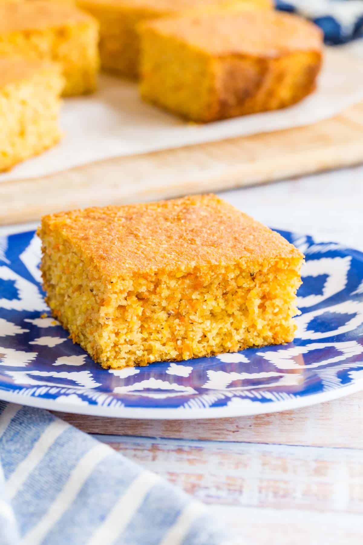 one square of cornbread on a blue and white plate