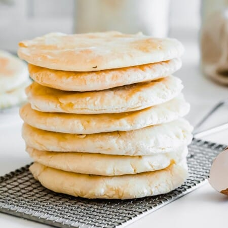 a stack of pita bread on a cooling rack
