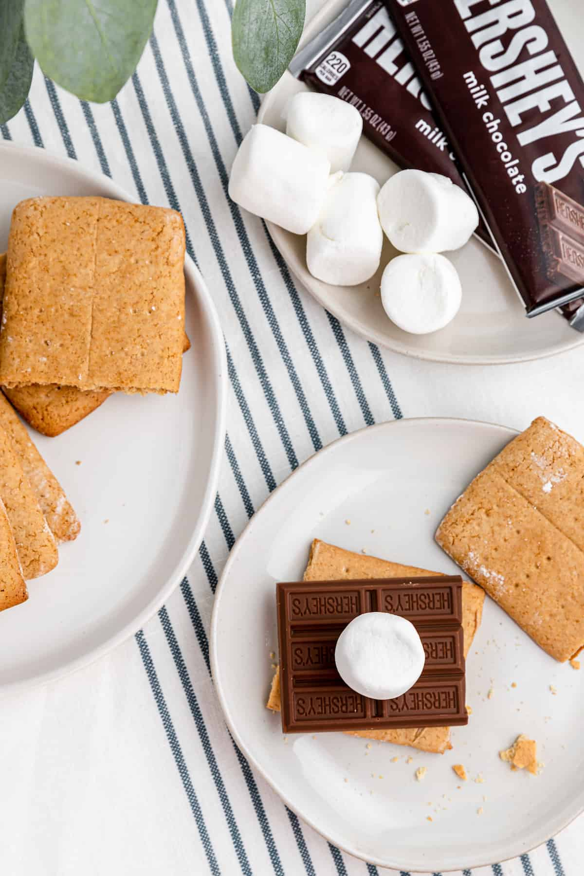 graham crackers with chocolate and marshmallows on plates