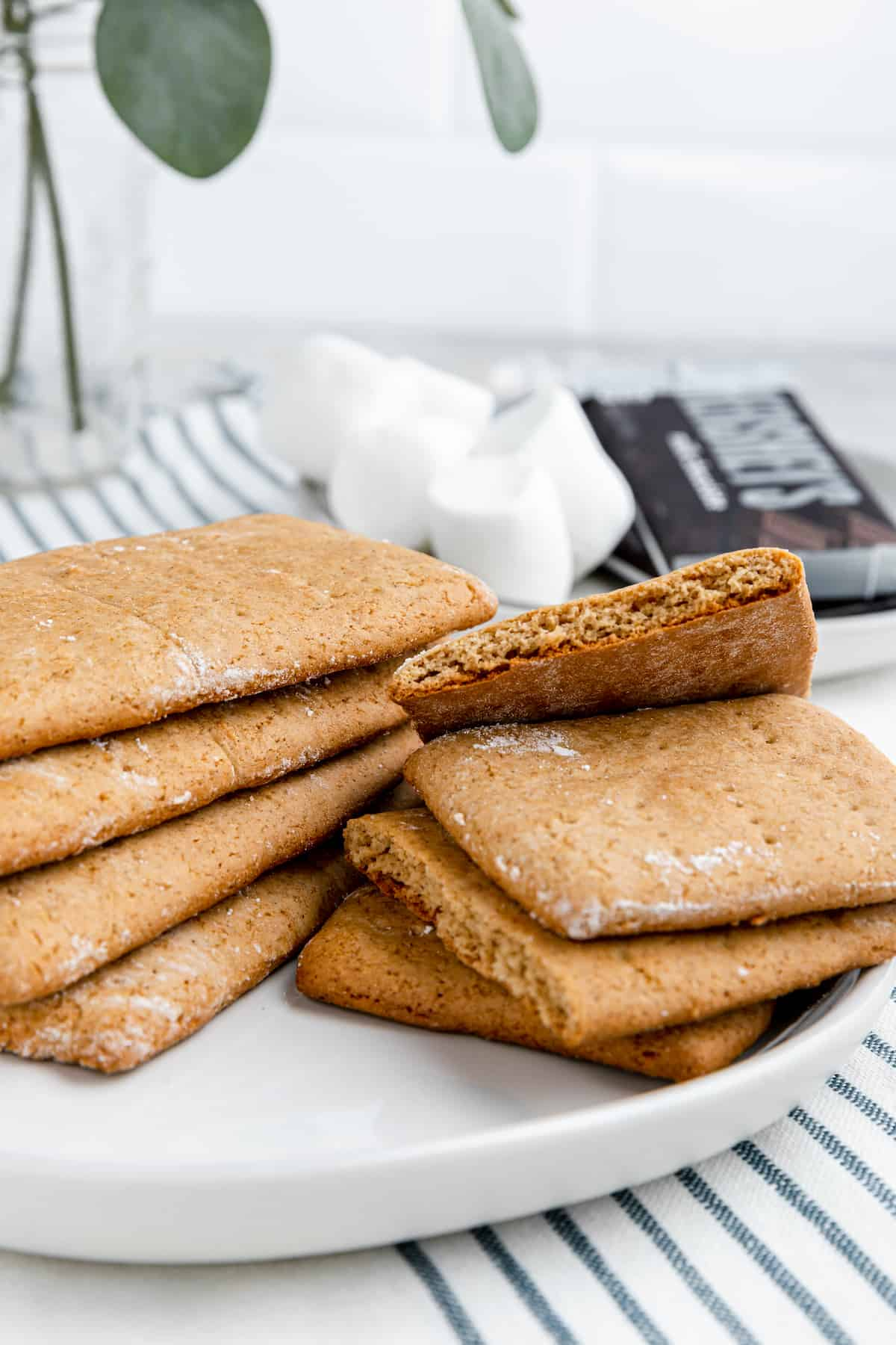 stacks of gluten-free homemade graham crackers on a white plate