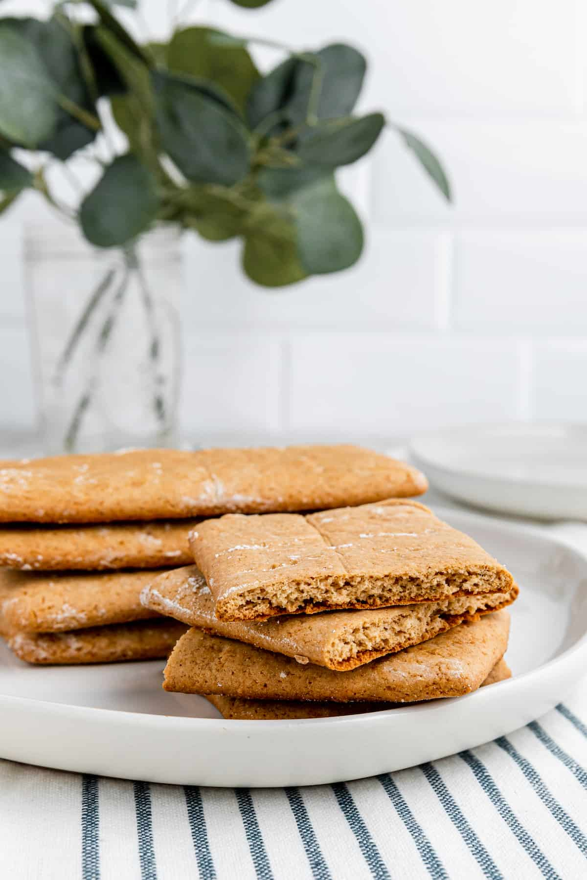 stack of gluten free graham crackers on a white plate