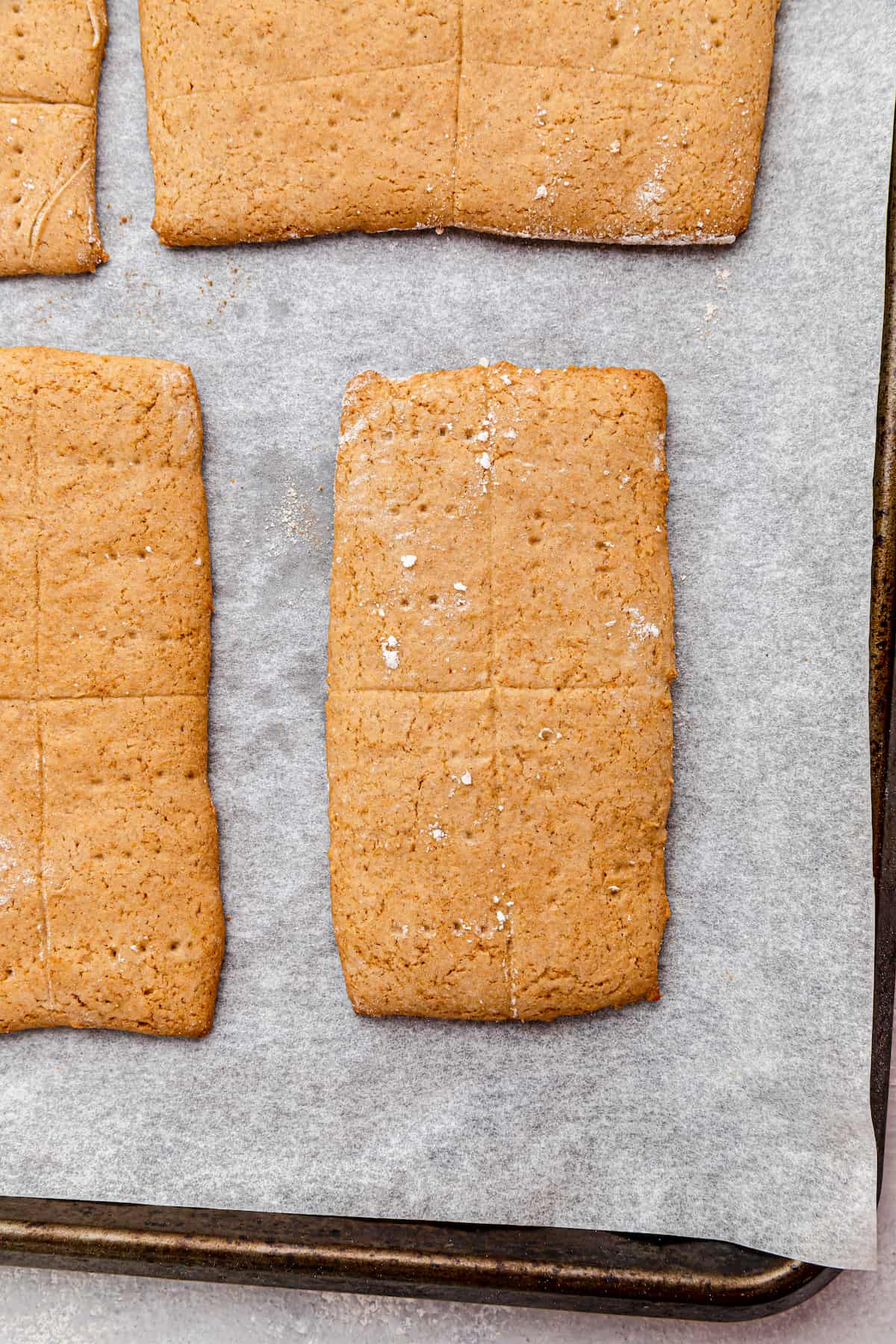 baked graham crackers on a parchment-lined baking sheet