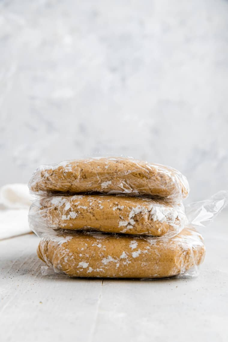 three pieces of graham cracker dough wrapped in plastic