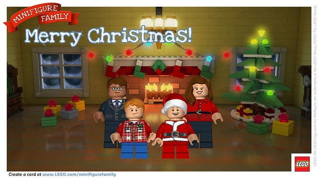 Four Smiling LEGO People in a Room with a Fireplace and a Christmas Tree