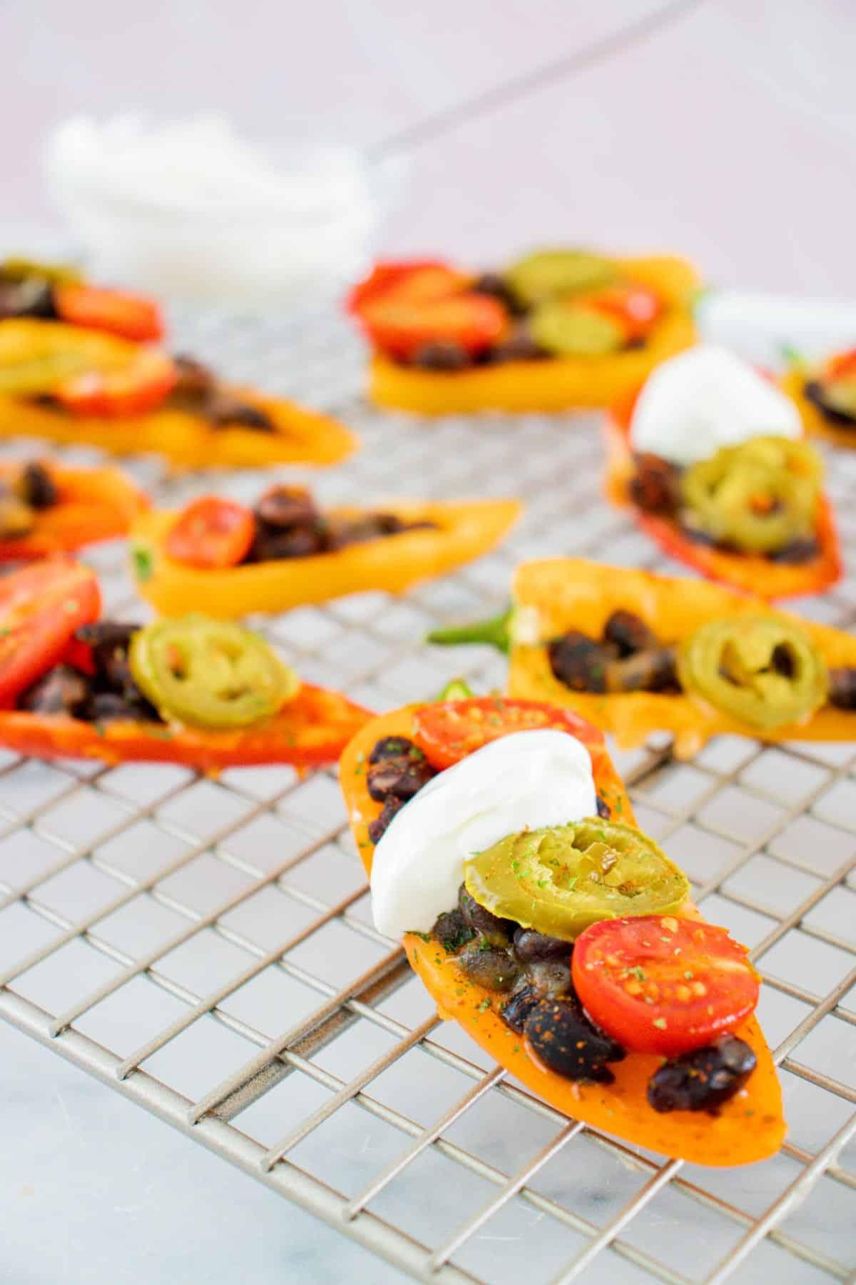 black bean bell pepper nachos on a cooling rack