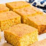 gluten free cornbread cut into squares on a cutting board