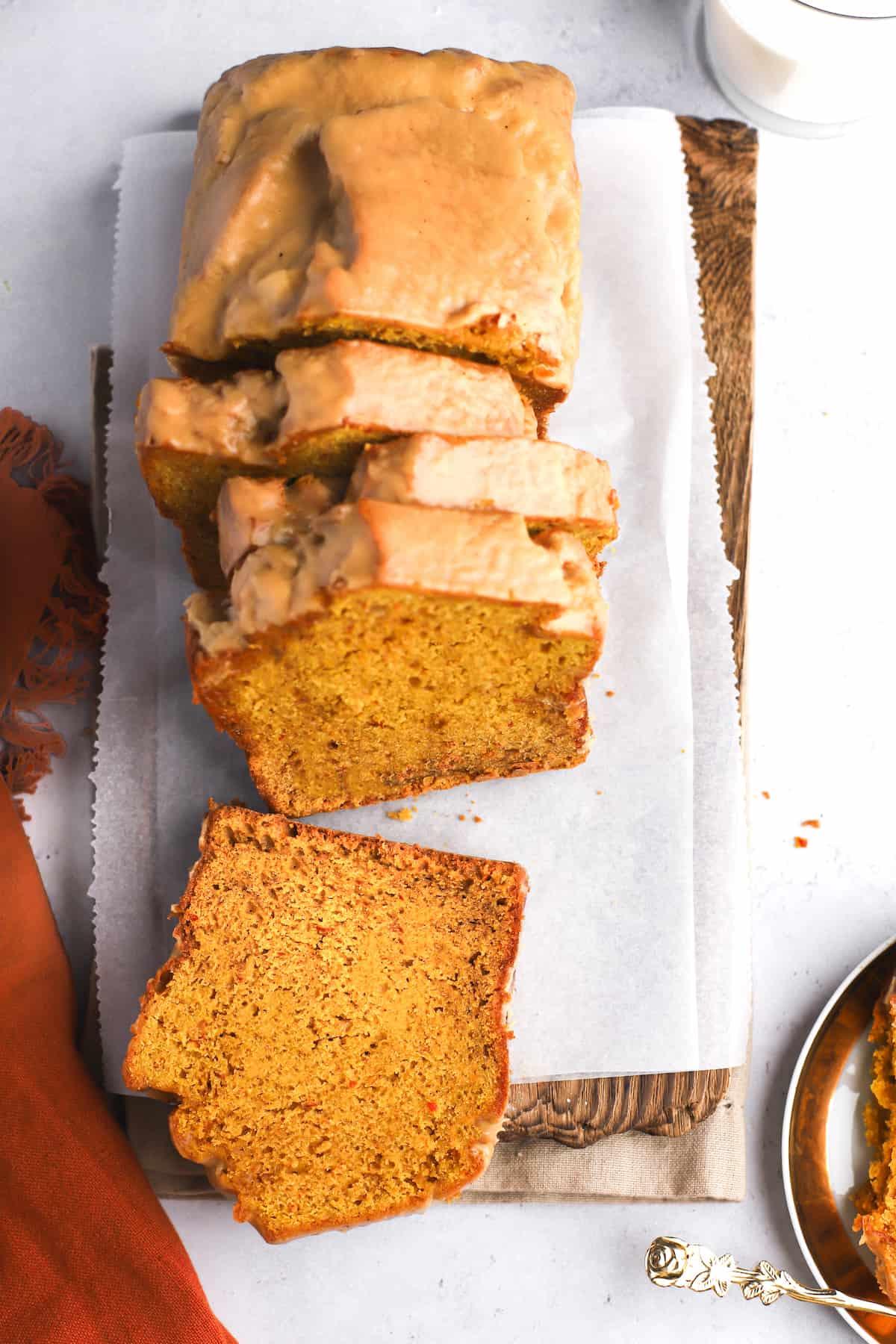 sliced loaf of pumpkin bread with glaze