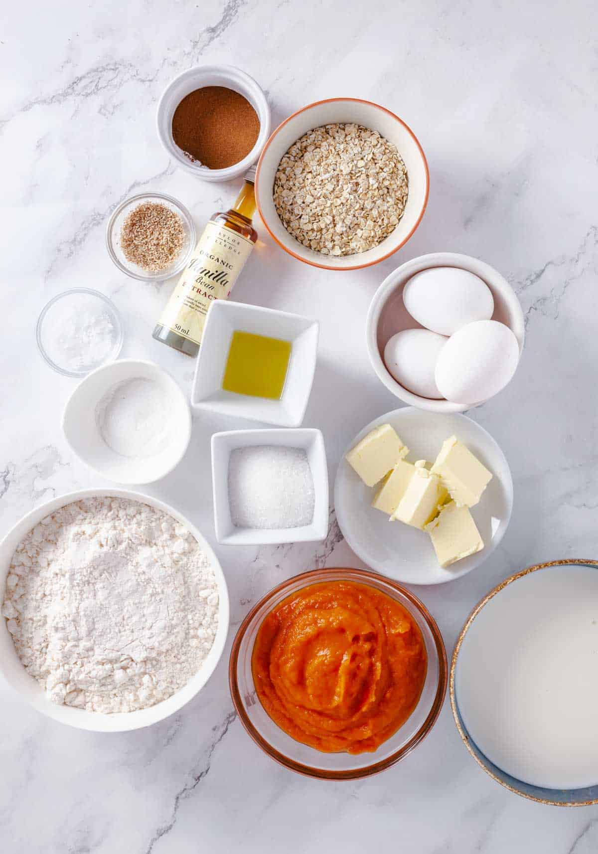 ingredients for pancakes with pumpkin, flour, eggs, sugar, andoats