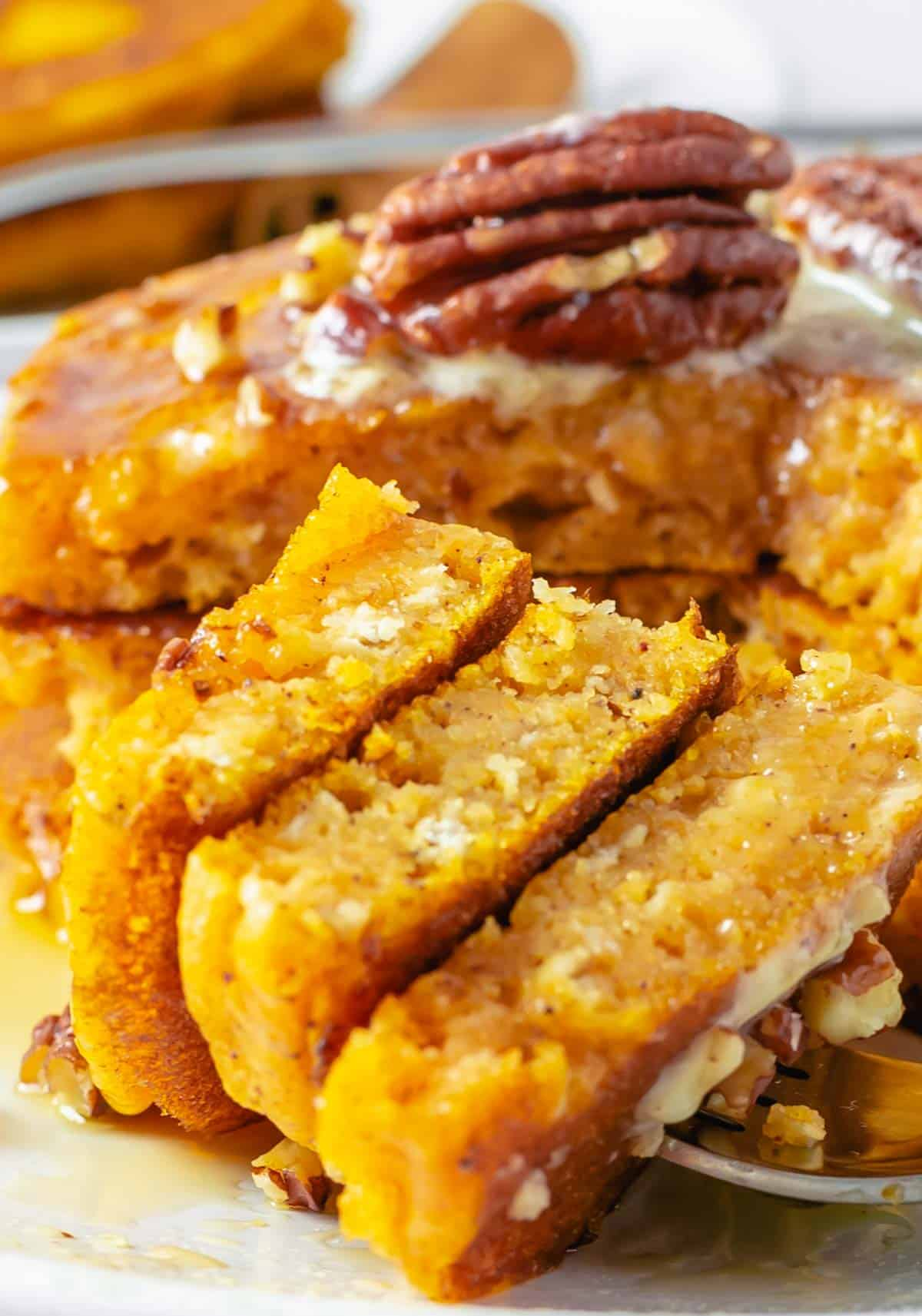 close up on fluffy pumpkin pancakes with nuts on top