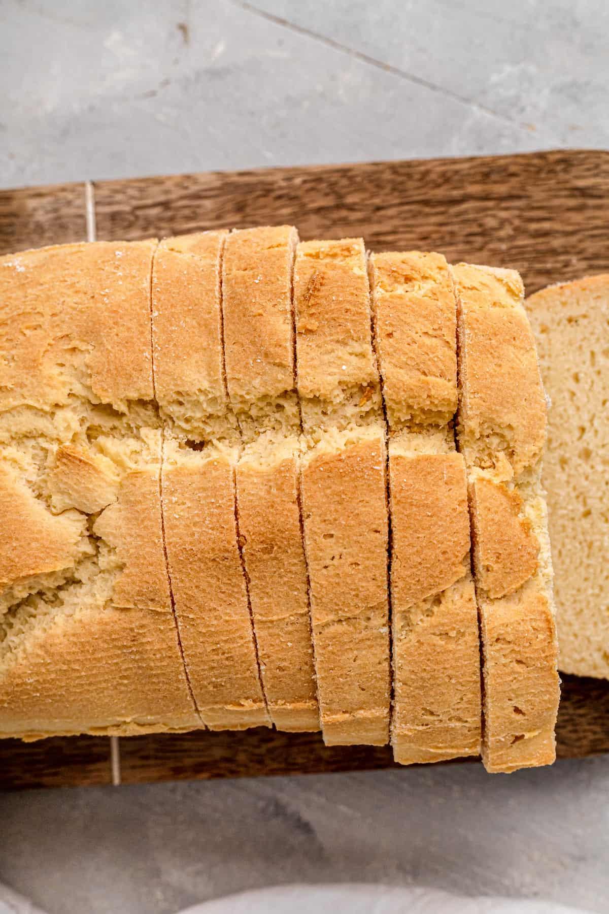 slices of gluten free sandwich loaf on a wooden board