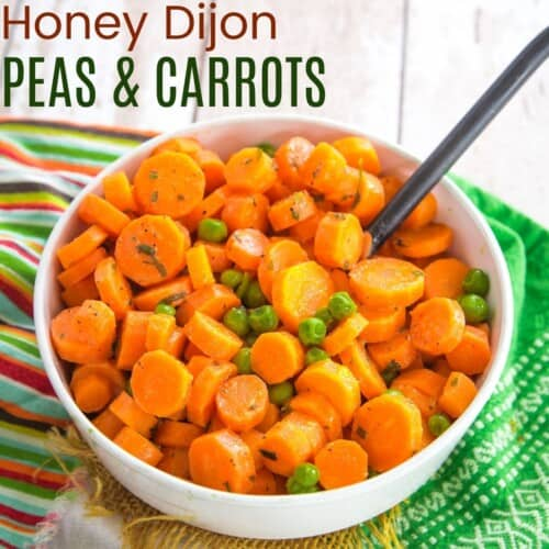 a bowl of honey mustard glazed carrots and peas on top of striped, green, and burlap napkins
