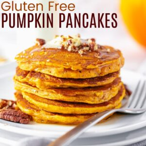 a stack of pumpkin pancakes on a plate topped with melted butter, chopped pecans, and maple syrup